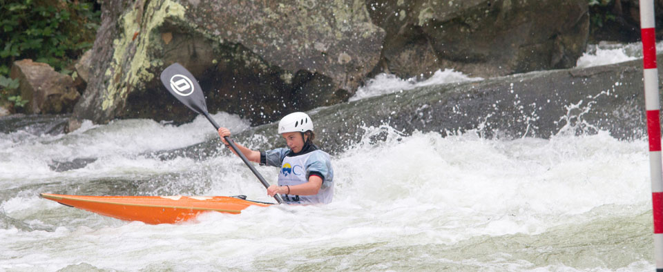NRC Competitive Team youth athlete Lili Brandon negotiates Nantahala Falls during the 2015 US Slalom Nationals, hosted by Nantahala Racing Club on the Nantahala River.